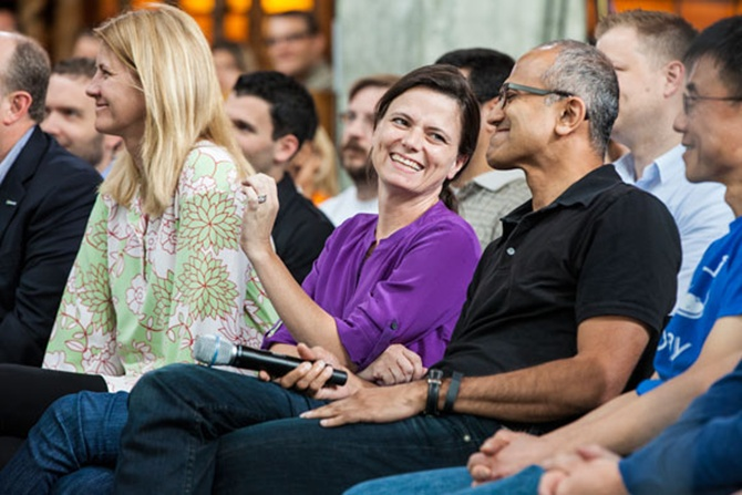 Senior Microsoft executives Tami Reller (left), Amy Hood, Satya Nadella and Qi Lu participate in a One Microsoft Town Hall event.
