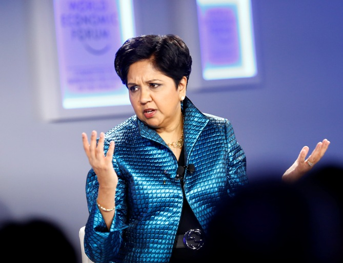 Indra Nooyi, Chairman and Chief Executive Officer of PepsiCo gestures during a session at the annual meeting of the World Economic Forum in Davos January 24, 2014.