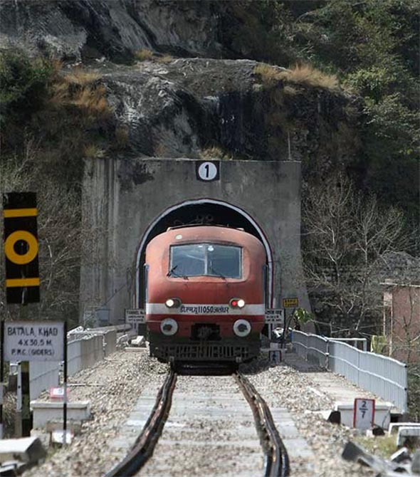 A passenger train travelling the Jammu-Udhampur rail line comes out of a tunnel on the outskirts of Jammu.