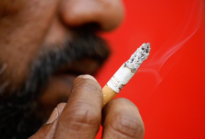 Cigarette cos hit hard on GST panel suggestion; ITC slumps 6.5%