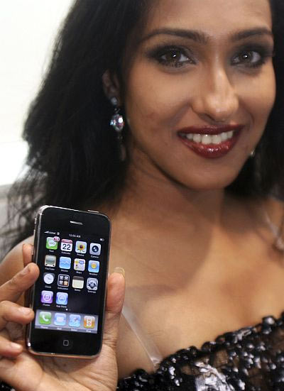 Actress Rituparna Sengupta holds her new Apple iPhone.