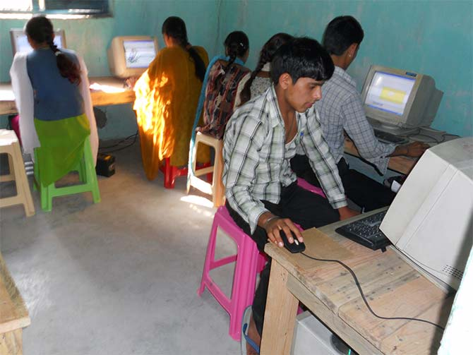 Boys and girls undergo training programmes on the basics of computer.