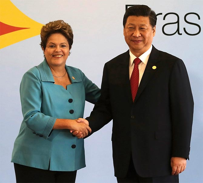 Brazil's President Dilma Rousseff shakes hands with China's President Xi Jinping before the 6th BRICS summit in Fortaleza.