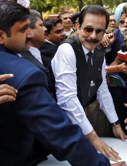 File photo of Sahara group chairman Subrata Roy (C) arriving at the Supreme Court in New Delhi on March 4, 2014.