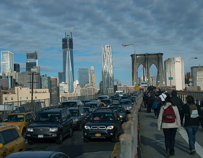 Commuters make their way across the Brooklyn Bridge in New York.