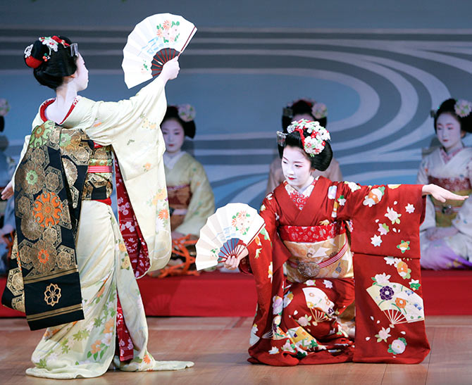 Maiko, (apprentice geisha) perform during an annual spring dance performance at the Kaburenjo theatre in the Miyagawa district of Kyoto.