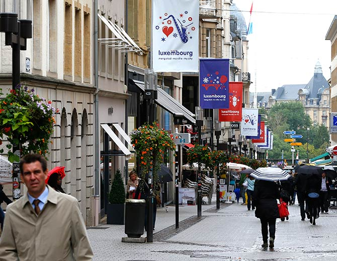 Pedetrians walk in the centre of the city of Luxembourg.