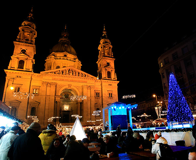 St. Stephens' Basilica is pictured behind a Christmas market in downtown Budapest.