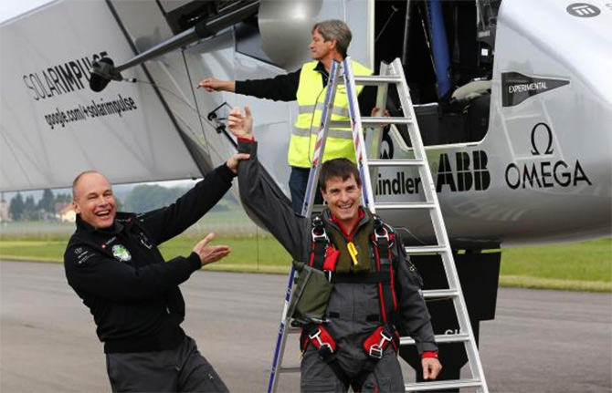 Solar Impulse co-founder Bertrand Piccard (L) congratulates German test pilot Markus Scherdel (R) after steering the solar-powered Solar Impulse 2 aircraft on its maiden flight at its base in Payerne.