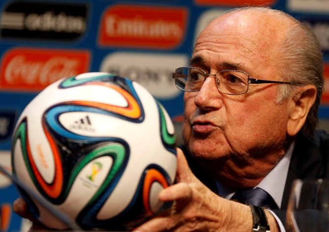 FIFA President Sepp Blatter holds an official 2014 FIFA World Cup soccer ball during a media conference in Sao Paulo June 5, 2014.