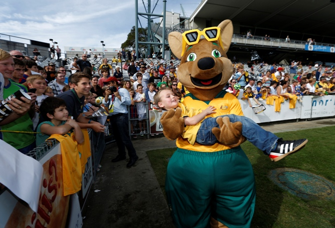 Maloo, the new mascot of Australia's Socceroos national soccer team, carries a soccer fan during a training session of the Socceroos team in Gosford, May 18, 2014.