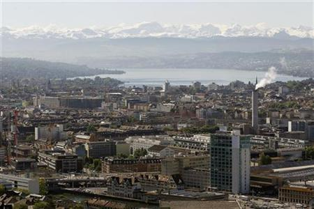 A general view shows the city of Zurich, Lake Zurich and the eastern Swiss Alps.