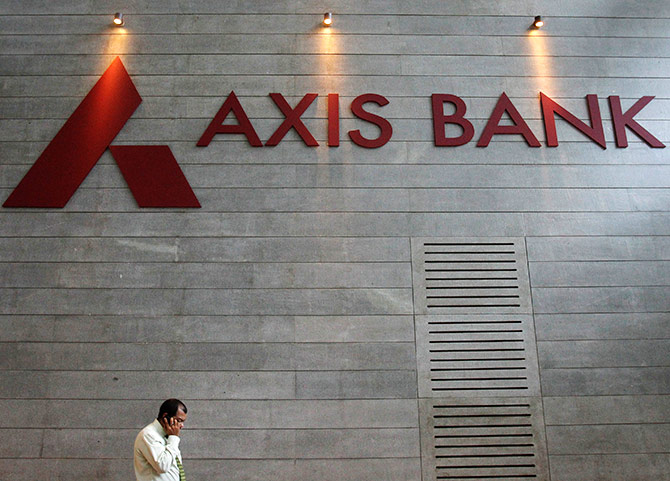 An employee speaks on his mobile phone as he walks inside Axis Bank's corporate headquarters.