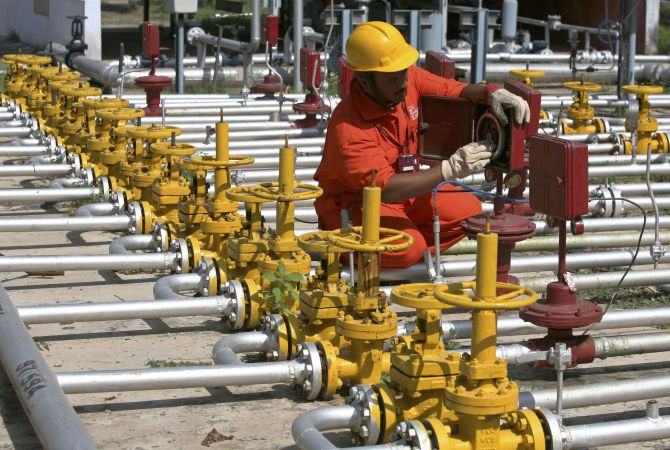 An engineer of Oil and Natural Gas Corp (ONGC) works inside the Kalol oil field in Gujarat.