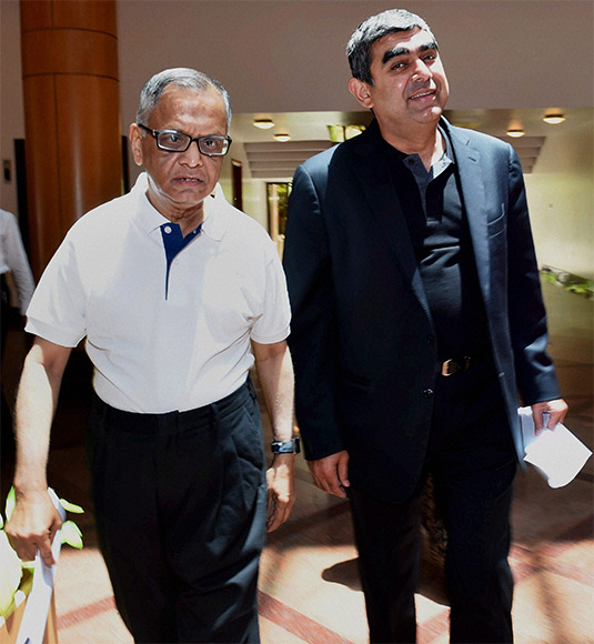 Infosys Executive Chairman N R Narayana Murthy with newly appointed CEO & MD Vishal Sikka arrives to attend a press conference at Infosys headquarters in Bengaluru.