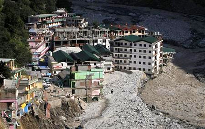 Buildings destroyed during floods are seen next to the Alaknanda river in Govindghat in Uttarakhand on June 22, 2013.