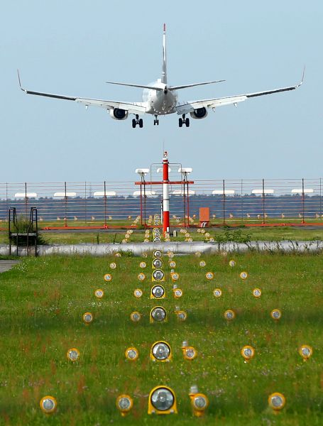 A passenger plane arrives at Schoenefeld Airport, Germany.