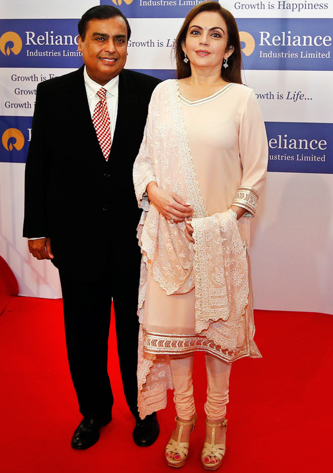 Reliance Industries Chairman Mukesh Ambani with wife Nita Ambani at the company's annual shareholders' meeting in Mumbai.
