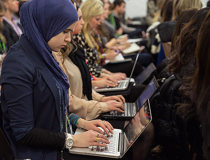 Attendees use their computers during a seminar at Social Media Week held in the Manhattan borough of New York.