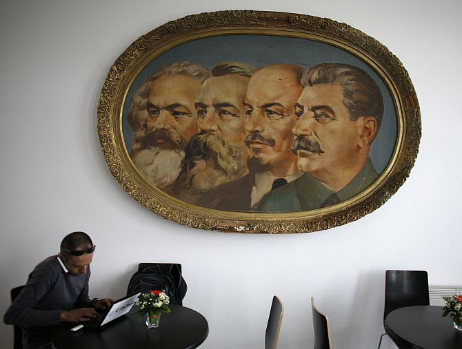 A man works on a laptop in a cafe of the newly opened Museum of Socialist Art in Sofia.