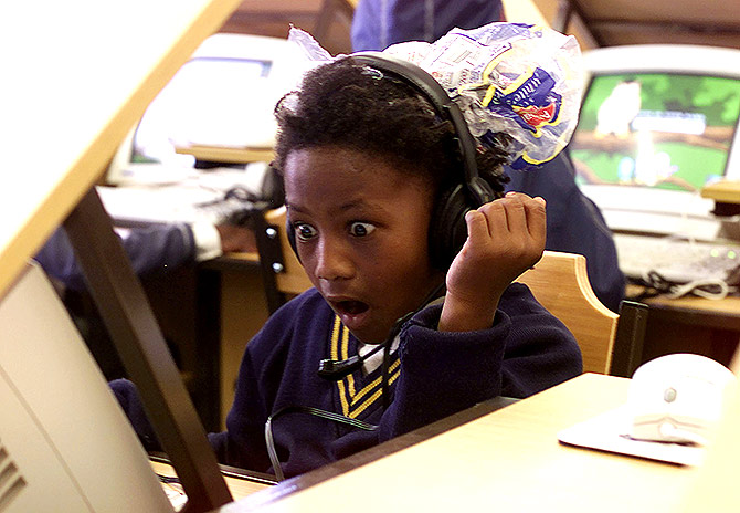 Eight year old Jenni-Lee Mason stares in awe as she uses a computer for the first time.