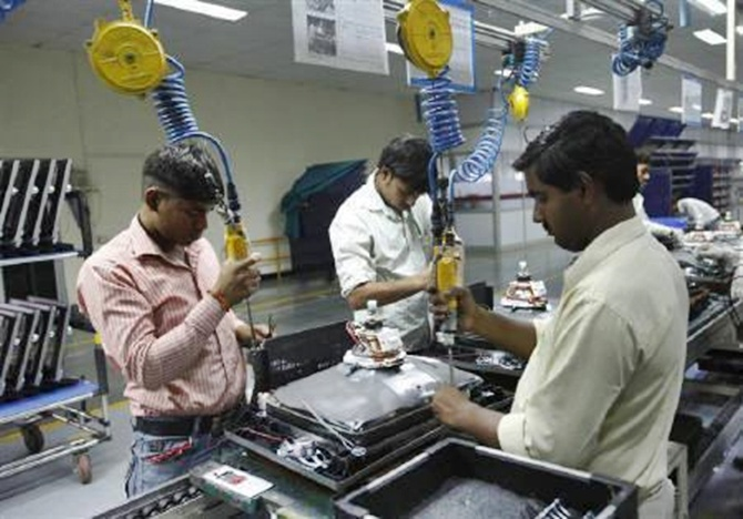 Workers at LG Electronics India Pvt Ltd. assemble television sets inside a factory at Greater Noida in Uttar Pradesh.