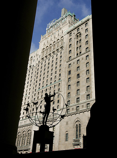 The historic Fairmont Royal York Hotel is photographed through Union Station's stone columns in Toronto.
