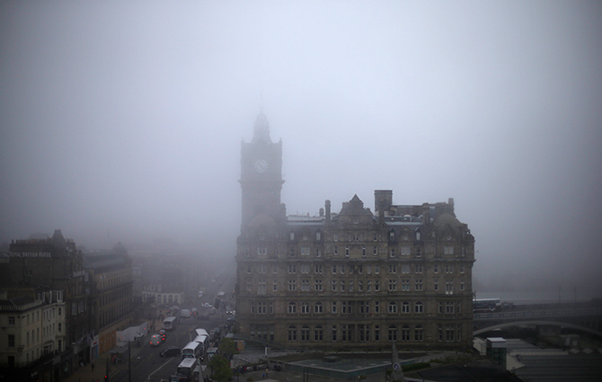 Fog surrounds the Balmoral Hotel in Edinburgh, Scotland.