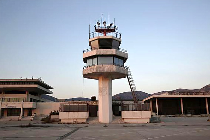 An auxiliary control tower stands in front of the east terminal of Hellenikon.