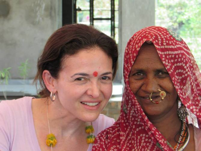 Facebook COO Sheryl Sandberg with a village woman at Kalthana Village, Rajasthan.