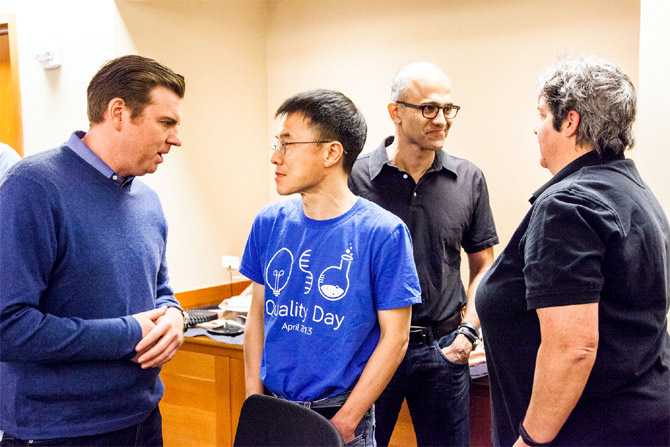 Senior leaders Tony Bates (left), Qi Lu, Satya Nadella and Lisa Brummel backstage, preparing for the One Microsoft Town Hall event in July.