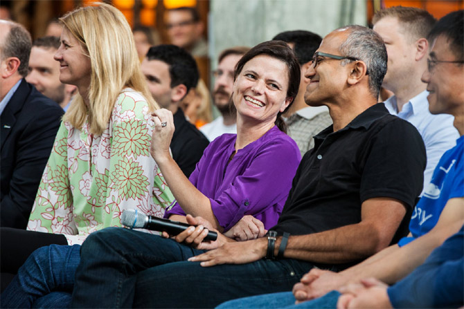 Senior leaders Tami Reller (left), Amy Hood, Satya Nadella and Qi Lu participate in the One Microsoft Town Hall event.