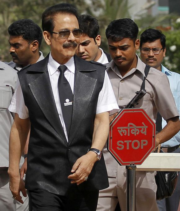Sahara Group Chairman Subrata Roy accompanied by his security leaves the Securities and Exchange Board of India (SEBI) headquarters in Mumbai.