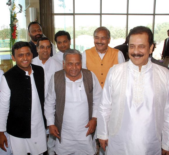 (From L - R) UP Chief Minister Akhilesh Yadav, his father and Samajwadi Chief Mulayam Singh, and Sahara India chief Subrata Roy.