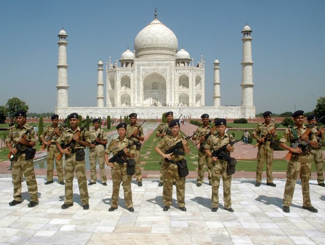 India's paramilitary troopers stand guard inside the historic Taj Mahal.