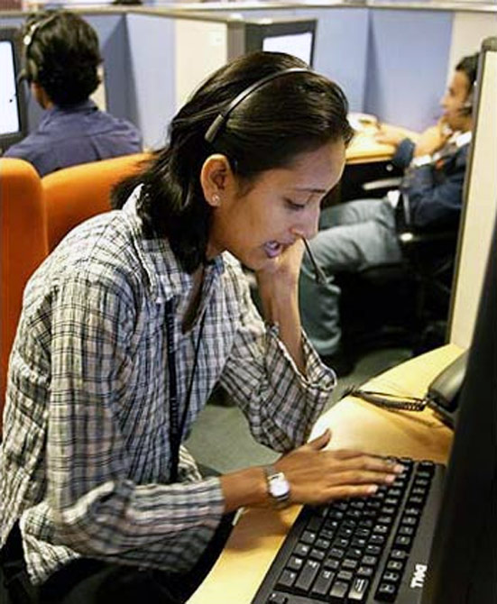 An Indian employees at a call centre provide service support to international customers.