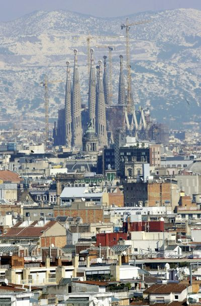 Gaudi's Sagrada Familia and Barcelona's skyline are seen against the backdrop of snow-covered Tibidabo mount after a snowstorm.