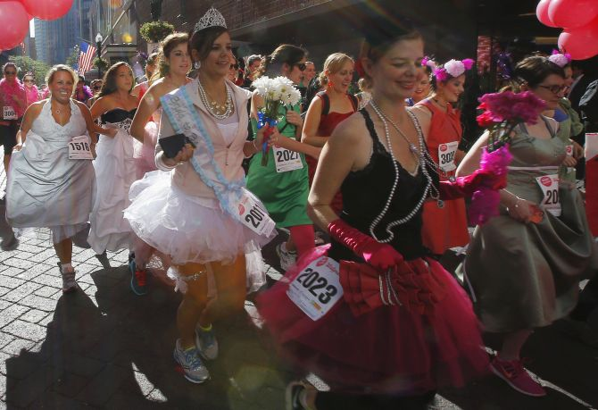 Participants leave the starting line at the annual Running with The Bridesmaids event in Boston.