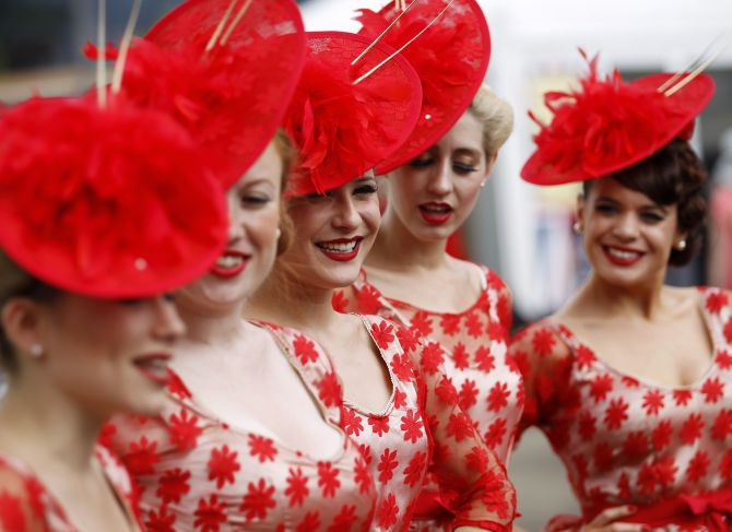 A girl band called the Tootsie Rollers sing on Ladies' Day, southwest of London.