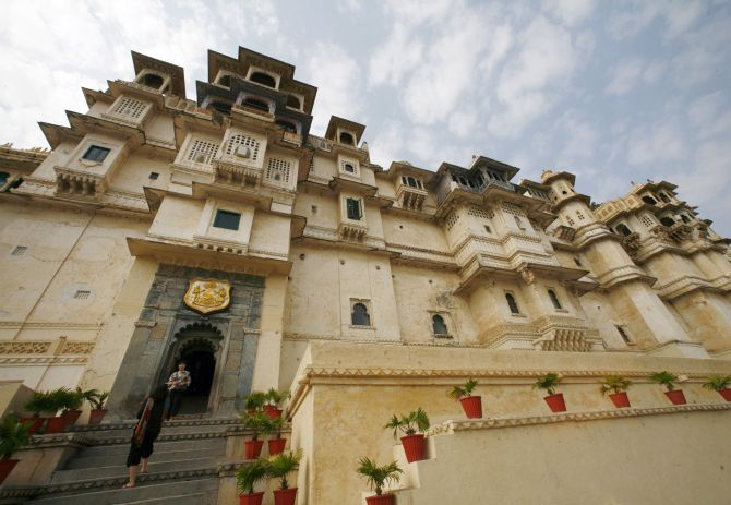 Tourists stand at the City Palace in Udaipur.