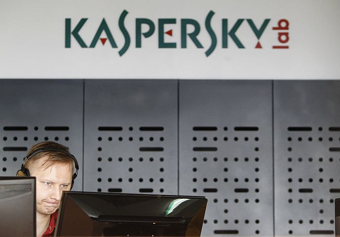 An employee works near screens in the virus lab at the headquarters of Russian cyber security company Kaspersky Labs.