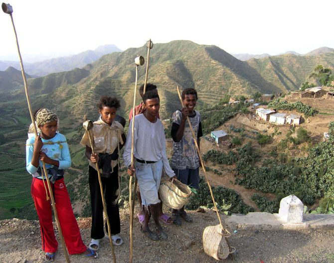 Eritrean kids pose for the camera before heading up the mountainside.
