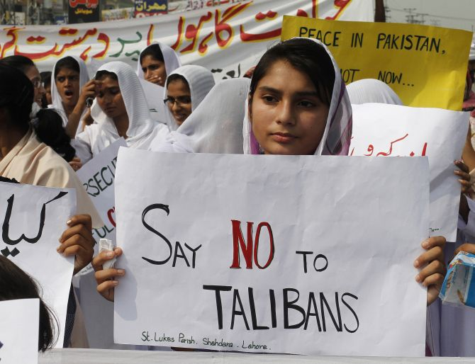 Members of the Pakistani Christian community hold placards during a protest rally in Lahore.