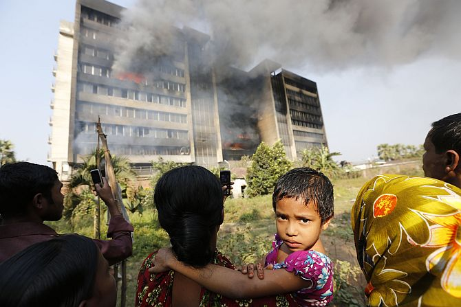Garment workers gather in front of the Standard Group garment factory which was on fire in Gazipur.