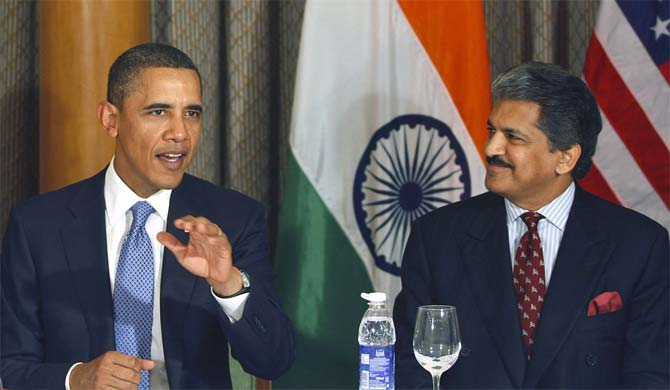 U.S. President Barack Obama as Mahindra & Mahindra Ltd. Managing Director Anand Mahindra watches during Obama's meeting with entrepreneurs in Mumbai.