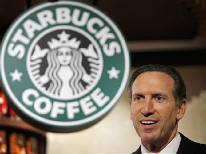 Starbucks Chief Executive Howard Schultz attends a news conference in Tokyo.