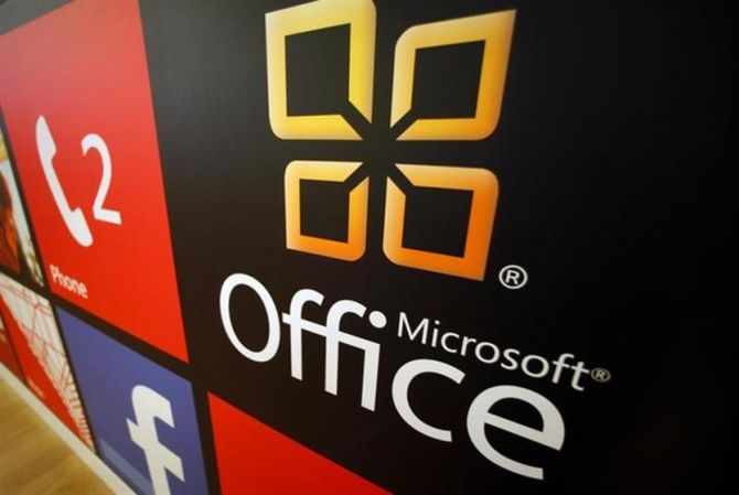 A Microsoft Office logo is shown on display at a Microsoft retail store in San Diego.