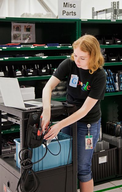 Rachel Mitchell preps a cart to repair the servers that store Google's corner of the Internet.