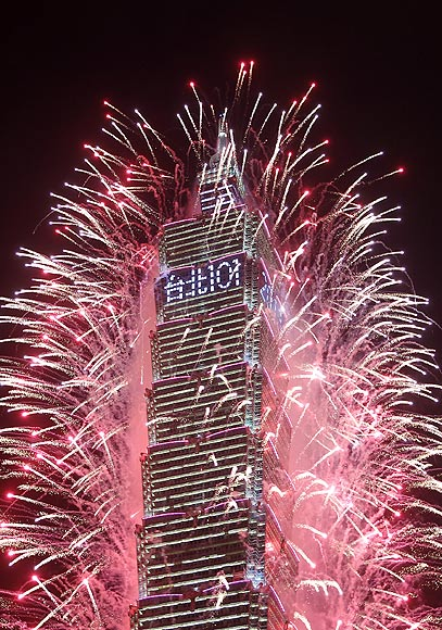Fireworks explode from Taiwan's tallest skyscraper, the Taipei 101 during New Year celebrations in Taipei.