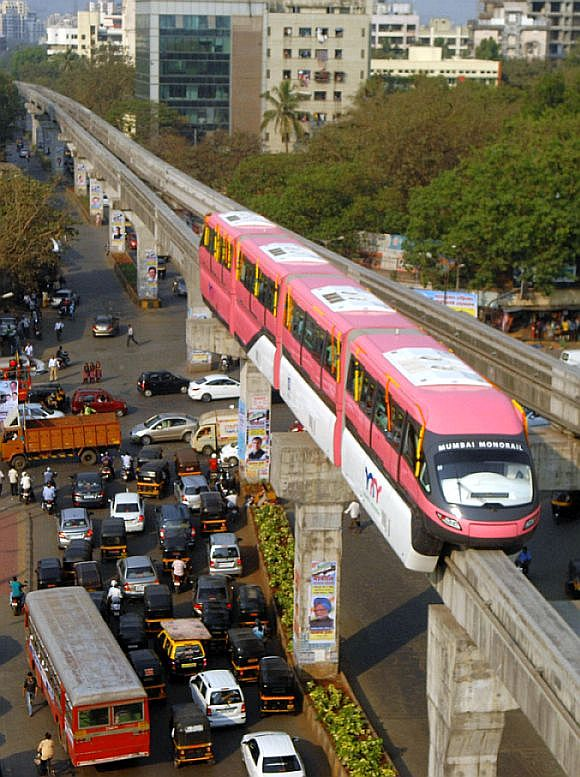 Monorail is seen against the skyline of Mumbai.